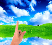 Pointing a finger at the sky — Stock Photo