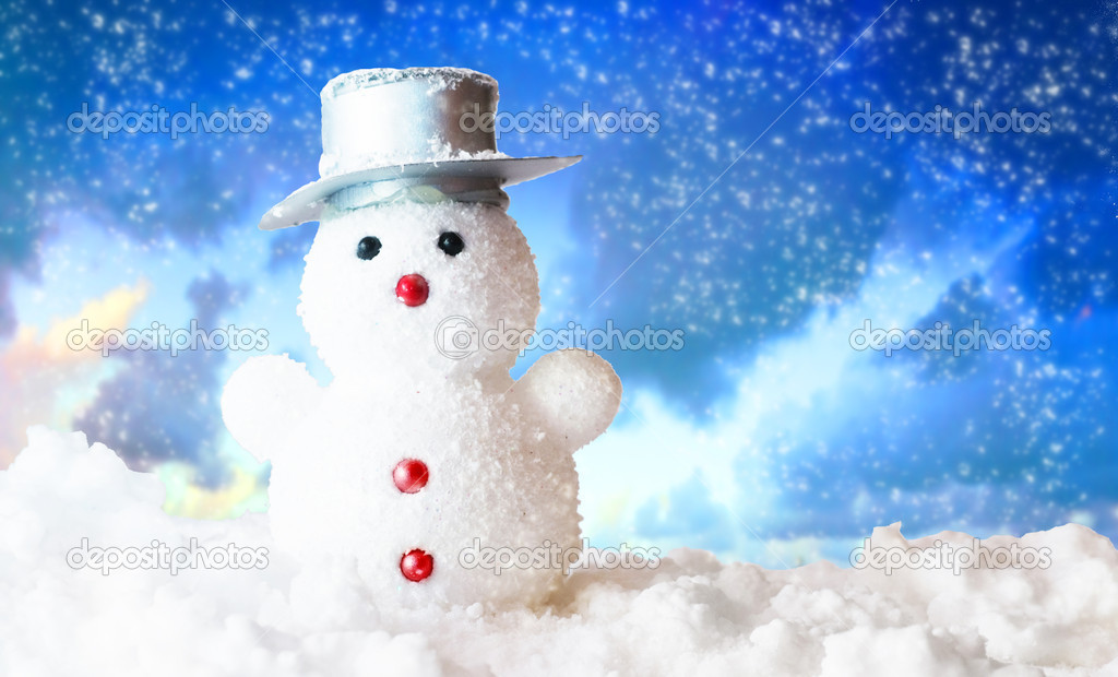 Christmas snowman figure on snowy sky. Shot in studio for perfect effect — Stock Photo #2031243