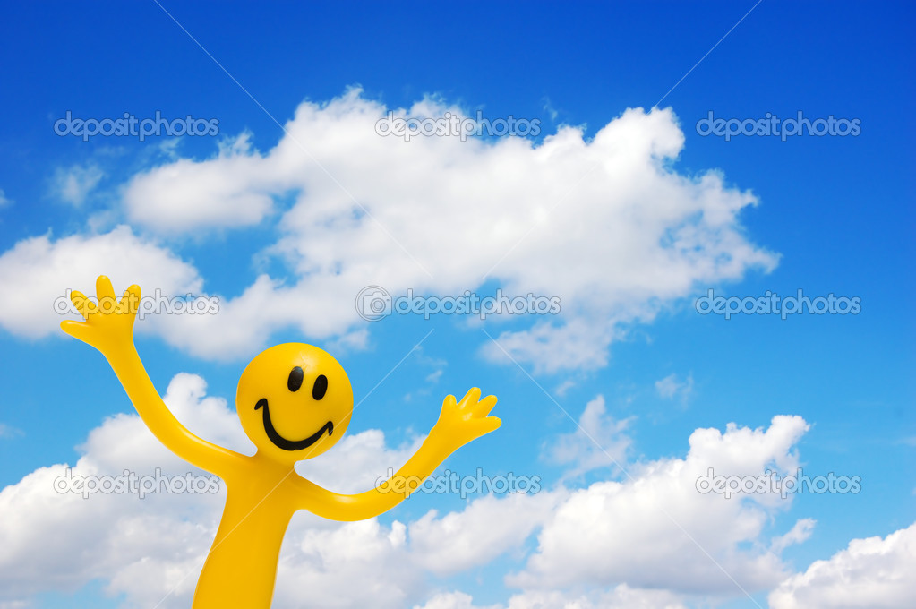 A happy face with arms raised on blue sky. Conceptual  Stock Photo #2035388