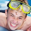 Playful boy in a pool — Stock Photo