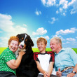 Grandparents, grandson and dog — Stock Photo