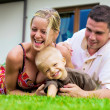 Happy family in front of the house - Stock Photo