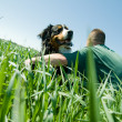 Man with a happy dog — Stock Photo