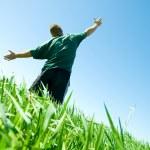 Happy man on the summer field — Stock Photo