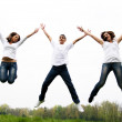 Happy friends jumping — Stock Photo