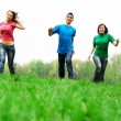 Happy friends jumping — Stockfoto #2047962