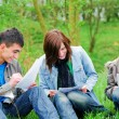 Foto de Stock  : Young students learning outdoor