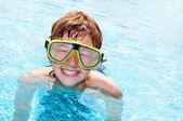 Happy boy in a pool — Stock Photo