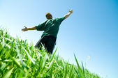 Happy man on the summer field — Stock Photo