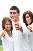 Happy friends giving okey sign — Stock Photo