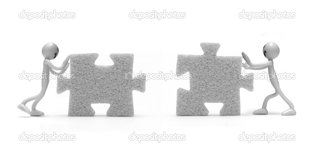 Putting two pieces of puzzles together. Conceptual image  Stock Photo #2043965