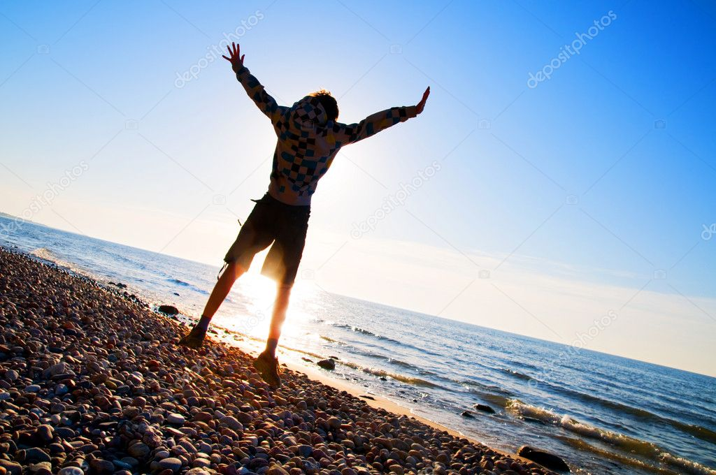 Happy boy jumping for joy at the beach — Stock Photo #2045288