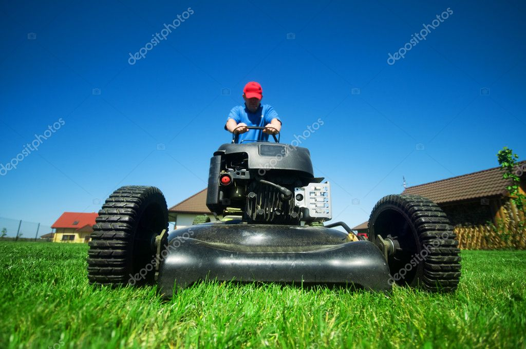 Man mowing the lawn. Gardening  — Stock Photo #2045810