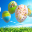 Falling easter eggs abstact background — Stock Photo