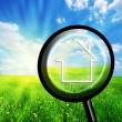 New house imagination in loupe - Stock Photo