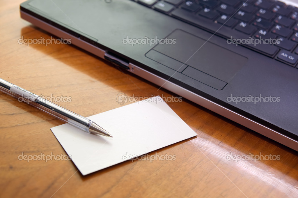 Modern business desk with laptop pen and business card  Stock Photo #2053613