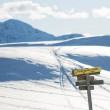 The signpost in the winter mountains — Stock Photo