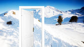 Winter version of door to new world — Stock Photo