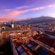 Foto Stock: Alpine town in sunset