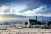 Alpine scenery with church in the frosty — Stock Photo