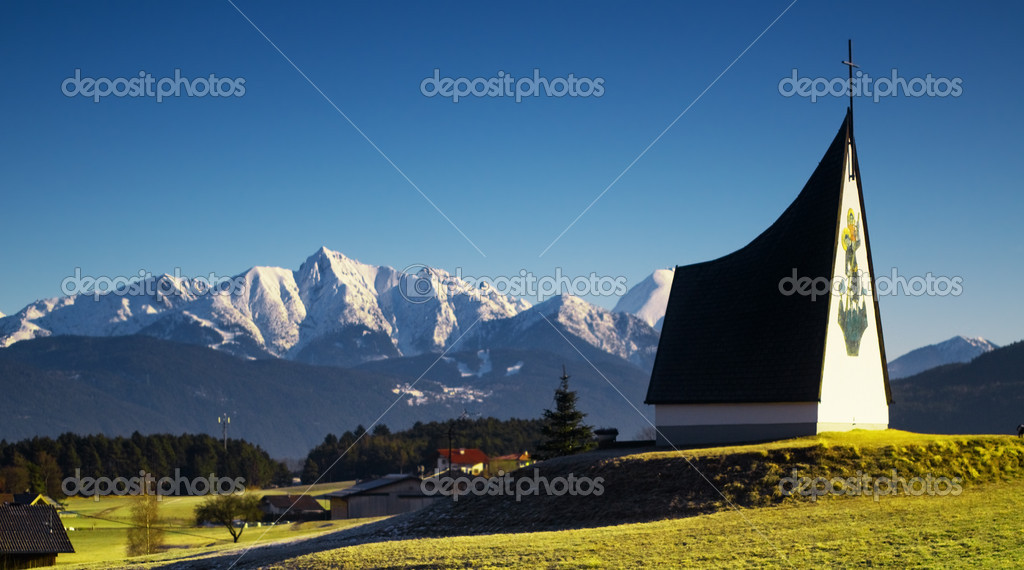 Spring Alpine landscape with blue sky and sun — Stock Photo #2070177