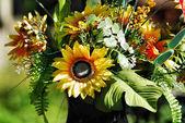 Plastic flowers in cemetery — Stock Photo