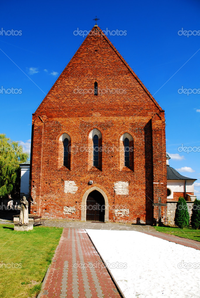 Old Gothic church against the blue sky. Zawichost, Poland  Stock Photo #2001220