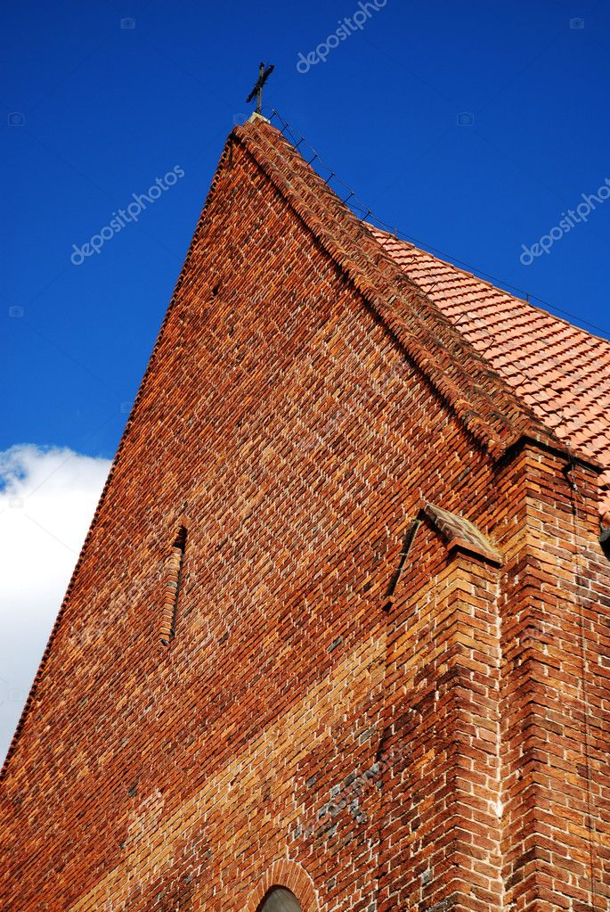 Gothic church tower against the blue sky  Stock Photo #2001393
