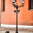 Antique style street lantern in front - Stock Photo