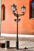 Antique style street lantern in front — Stock fotografie