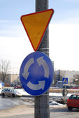 A roundabout sign — Stock Photo