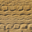 Stock Photo: Tyre tracks on beach