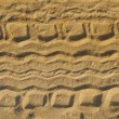 Tyre tracks on beach - Stock Photo