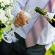 Man pouring champange to wineglass — Stock Photo