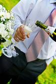 Man pouring champange to wineglass — Stock Photo