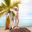 Girl and a palm — Stockfoto