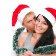 Стоковое фото: Young couple celebrating christmas