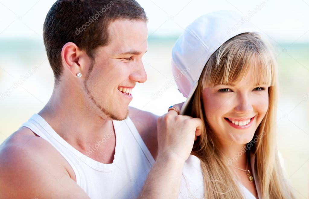 Happy couple standing on the beach near the ocean  Foto de Stock   #1744169