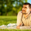 Man dreaming on a meadow — Stock Photo