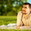Stock Photo: Man dreaming on a meadow