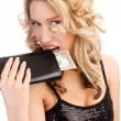 Woman biting a wallet — Stock Photo
