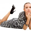 Lying woman in zebra dress - ストック写真