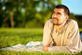 Man dreaming on a meadow — Stockfoto
