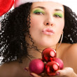 Stock Photo: Young woman in Santa's hat
