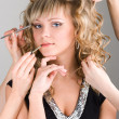 Young woman getting a make-up — Stockfoto