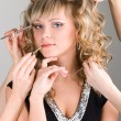 Young woman getting a make-up - Stock Photo