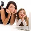 Mother teaching her daughter - Stock Photo