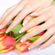 Manicure and tulips — Stockfoto