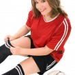 Young woman in soccer uniform — Stock Photo