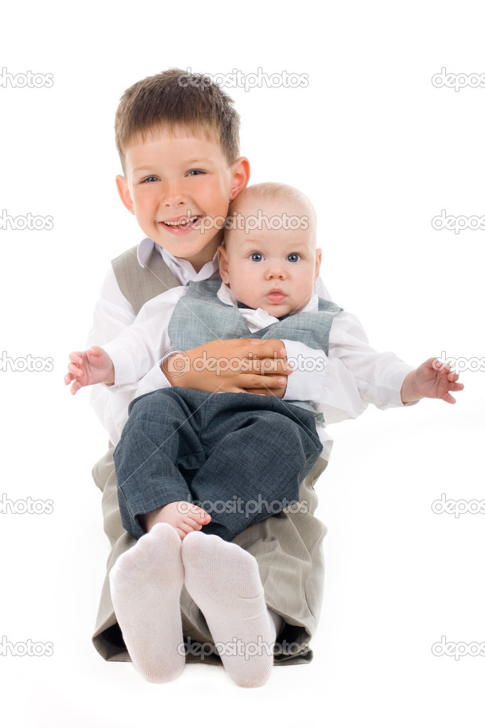 Elder kid holding his young baby brother — Stock Photo #1772356